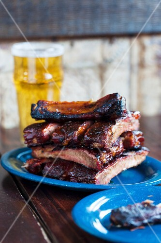 Grilled pork ribs and a glass of beer in a pub