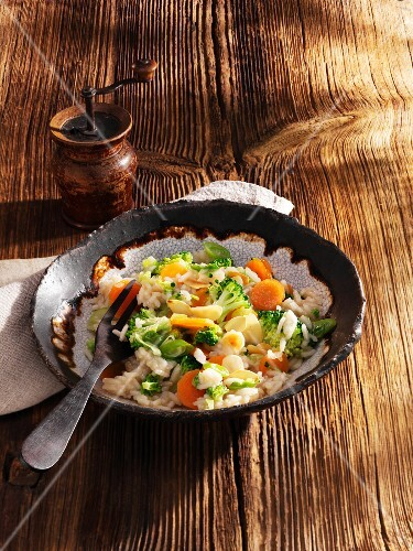 Rice with broccoli, carrots, beer and slivered almonds