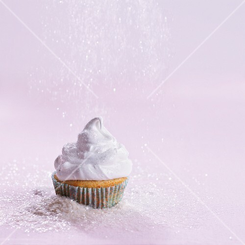 A cupcake sprinkled with grated coconut