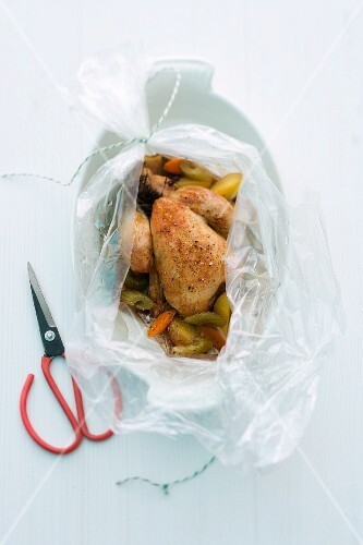 Spring chicken with vegetables baked in foil