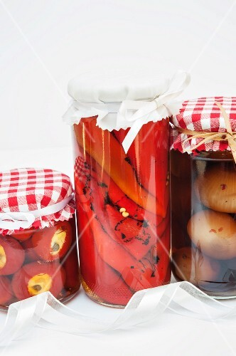 Jars of pickled peppers, chillis and onions as homemade Christmas presents