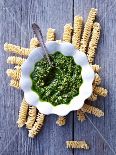 A bowl of pesto on raw pasta