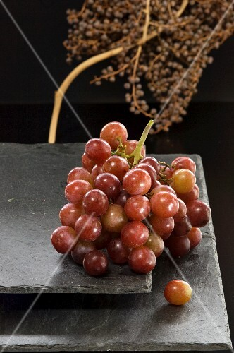 Red grapes on a slate platter