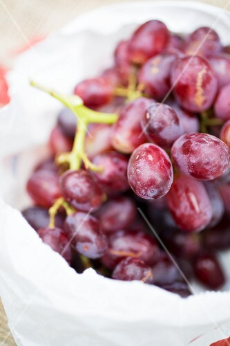 Red grapes in a plastic bag (close-up)