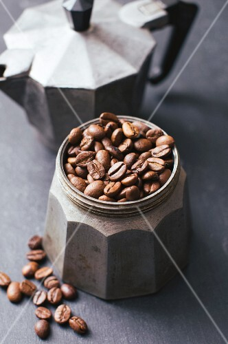 Coffee beans in vintage espresso maker