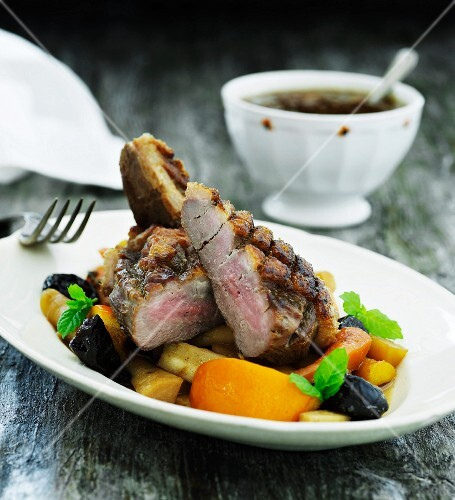 Beef steak with root vegetables and prunes