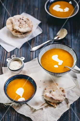 Spicy carrot soup with pistachio yogurt and naan bread