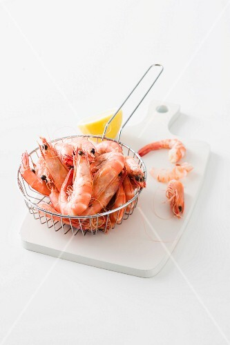 Cooked king prawns in a sieve