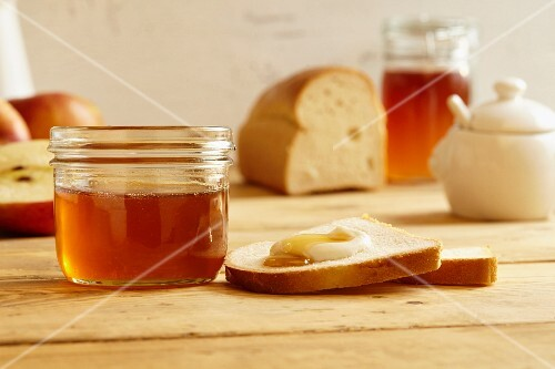 White bread with quark and honey next to a jar of honey