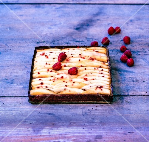 Salted caramel tart with mango and raspberries