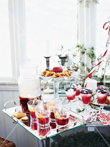 A Christmas buffet with drinks and desserts
