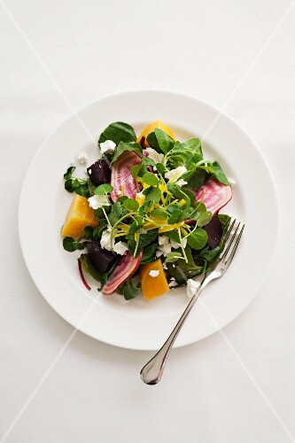 Beetroot and golden beet salad with watercress and goat's cheese