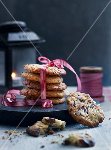 Christmas cookies on a black wooden board