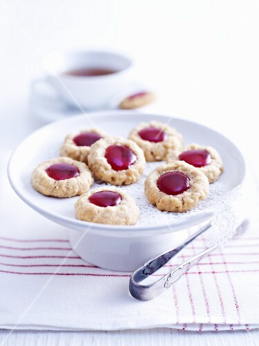 Husarenbusserl (shortbread jam biscuits) on a cake stand