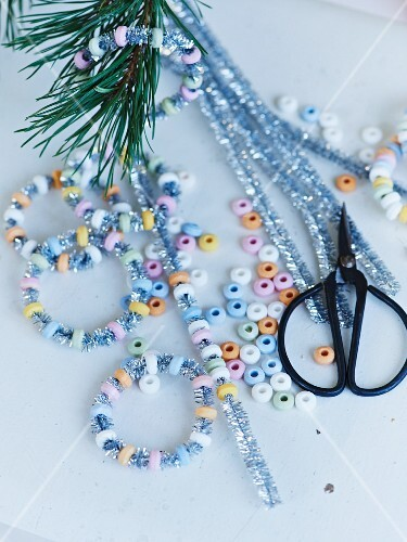 Hand-crafting glittery, sugar-bead hoops for Christmas tree