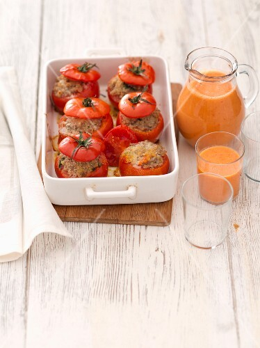 Stuffed tomatoes and gazpacho in a jug and a glass