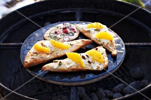 Winter pizzas on a charcoal grill
