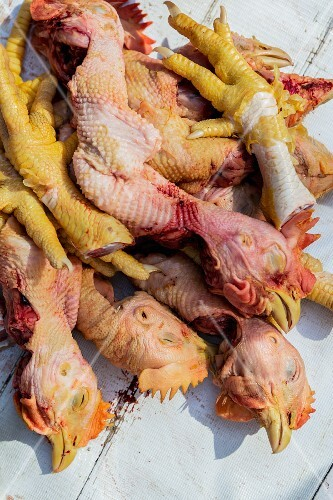 Fresh chicken heads and feet at a market in Myanmar