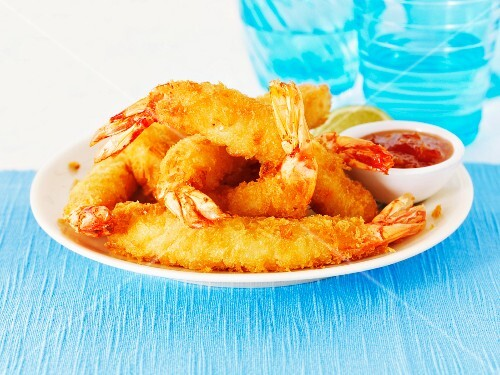 Battered king prawns with a dip