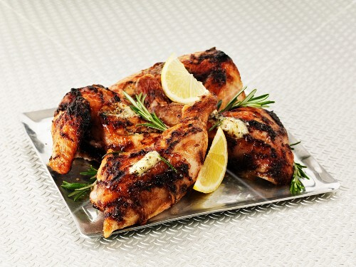 Lemon chicken with rosemary on a sliver platter