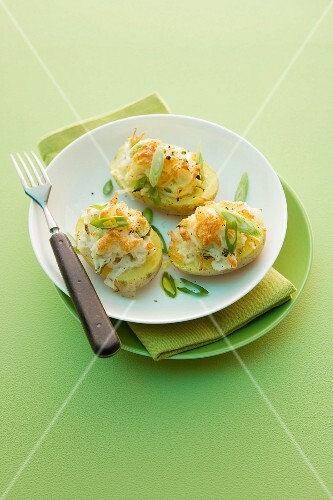 Potatoes with pineapple coleslaw and spring onions
