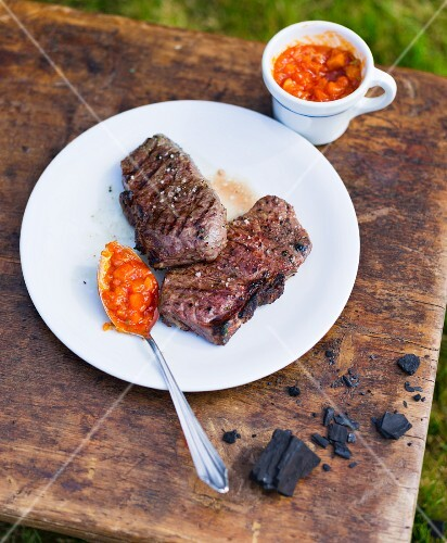 Grilled steaks with a tomato and peach salsa