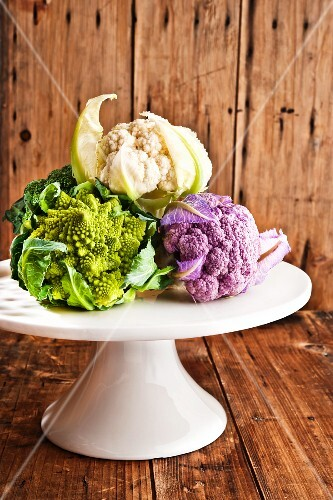 Mini vegetables (cauliflower, Romanesco broccoli) on a cake stand