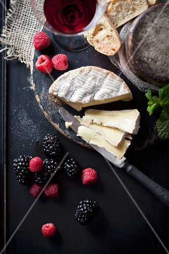 Camembert with fresh berries, bread and wine