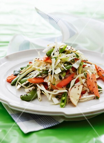 Raw vegetable salad with white cabbage and apple