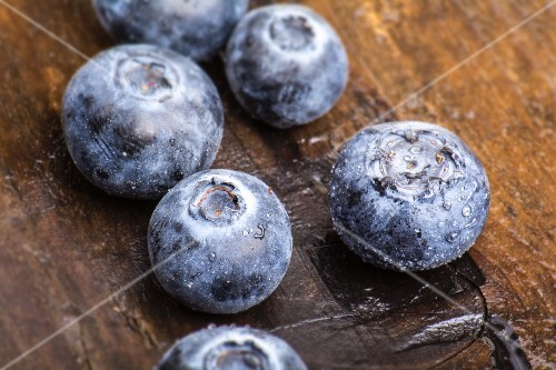 Blueberries on a wooden surface