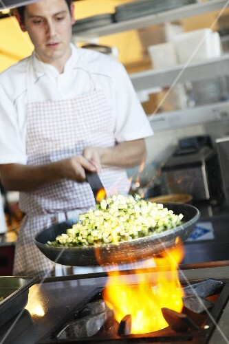 A chef frying food
