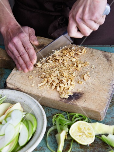 Waldorf salad being made: nuts being chopped