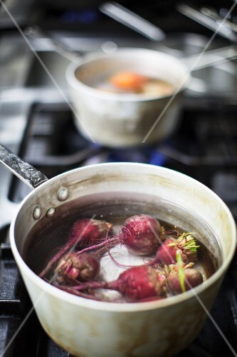Beetroot in a saucepan of water