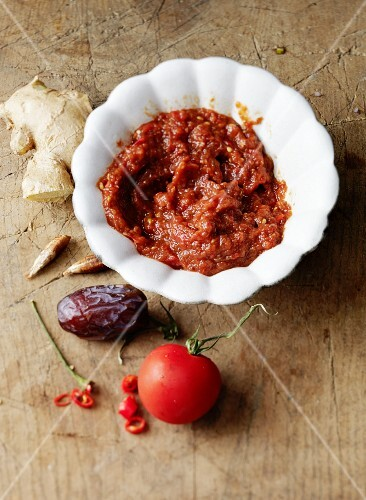 Raw tomato sauce with dates, ginger and chilli