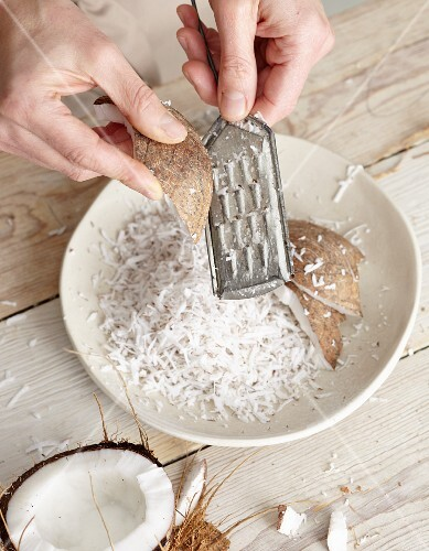 Coconut being grated