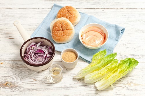 Ingredients for hamburgers: red onions, sugar, vinegar, mayonnaise with ketchup and cos lettuce