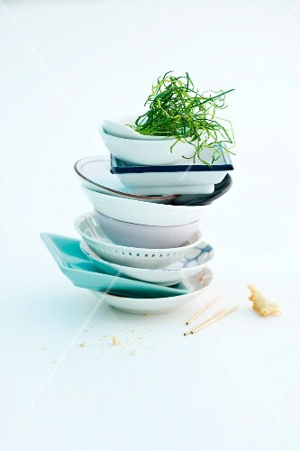 A stack of bowls with fried leek greens
