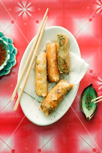 Spring rolls with various fillings on an oval platter