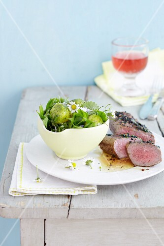 Lamb fillet and potato salad with wild herbs