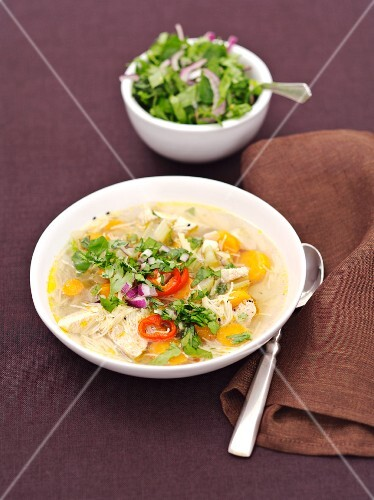 Chicken soup with vermicelli and herbs