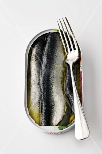 A tin of herring with a fork