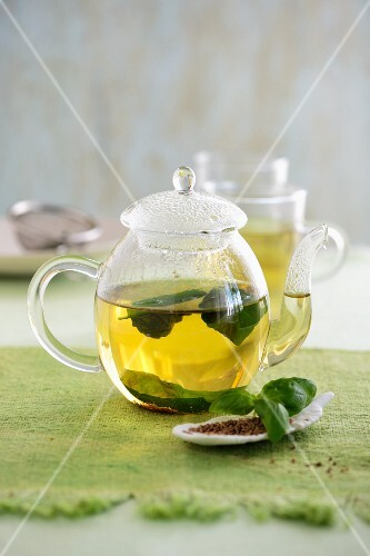 Tea made from aniseed and basil in a glass teapot