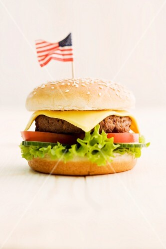A cheeseburger decorated with an American flag
