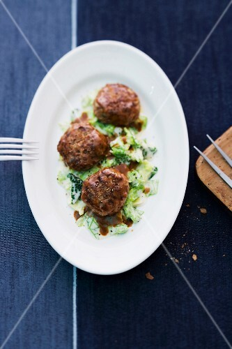 Goose burgers on a bed of creamy savoy cabbage