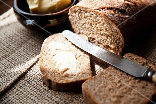 Freshly baked wholemeal bread with salted butter