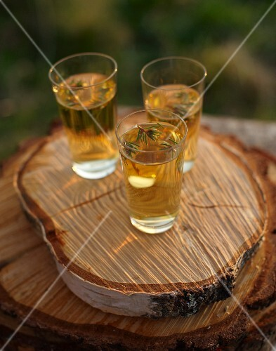 Apple juice garnished with spruce tips