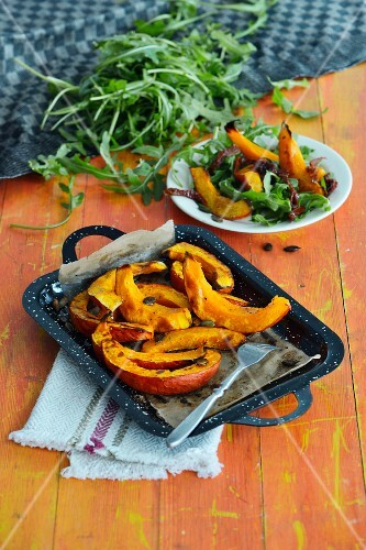 A salad with pumpkin wedges