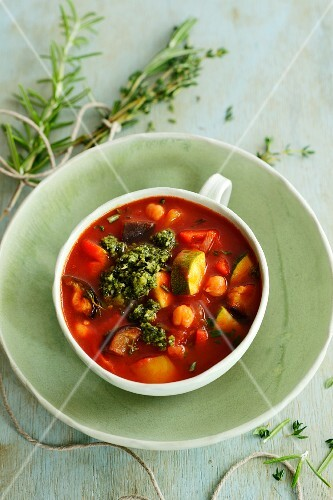 Summer vegetable soup with basil pesto