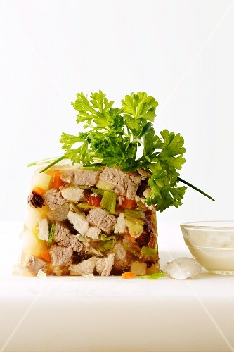 Meat and vegetables in aspic with parsley