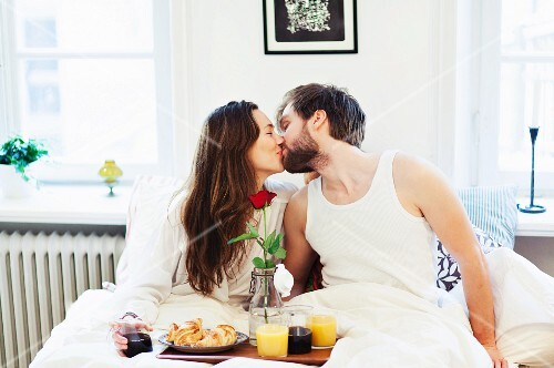 A good morning kiss and breakfast in bed